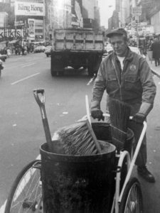 Coleman worked and wrote about his job as a street cleaner (photo, NYTimes)